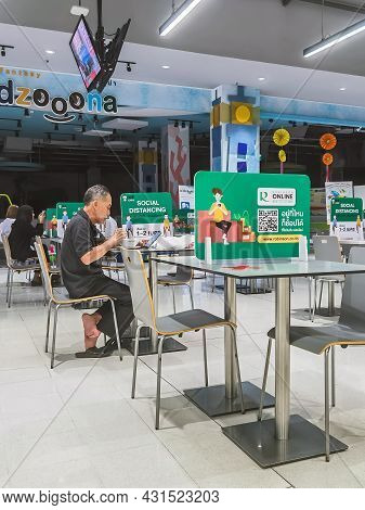 Kanchanaburi,thailand-june 11,2021 : Label Social Distancing Sign On Table,space Between People To A