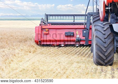 Agricultural Machinery, A Fragment Of A Large Combine Harvester During The Harvest Against The Backg