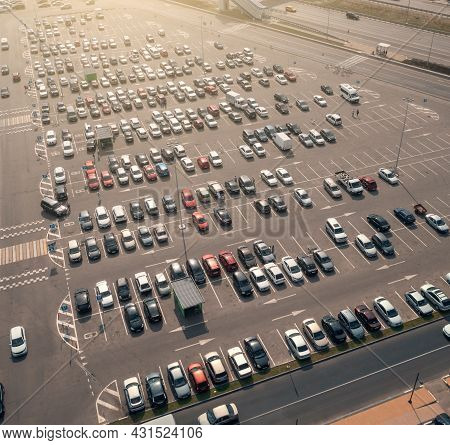 Parking Lot With Many Parked Cars At Business Center Or Mall, Aerial View. City Transportation Conce