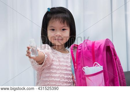 Beautiful Child Pack Bags To Go Back To School After The Virus Outbreak Subsides. Sweet Smiling Girl