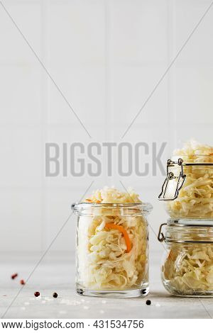 Sauerkraut In Glass Jars. Fermentation And Canning Of Vegetables. Copy Space.