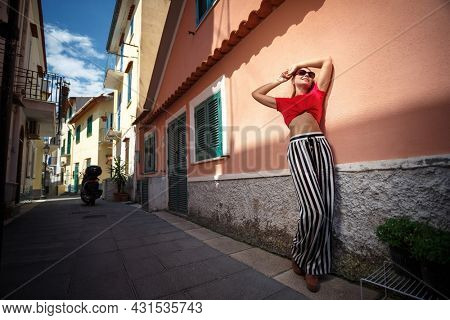Beautiful young woman on summer day