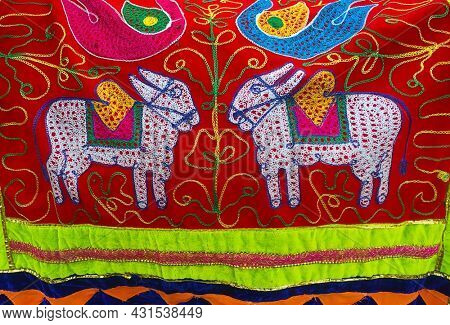 Colorful embroidered fabric with figure of two bulls. Pola is a festival celebrated by farmers in Maharashtra, to acknowledge the importance of bulls and oxen.