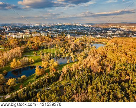 Aerial View Of A Lake In A Park With Autumn Trees. Kishinev, Moldova. Epic Aerial Flight Over Water.
