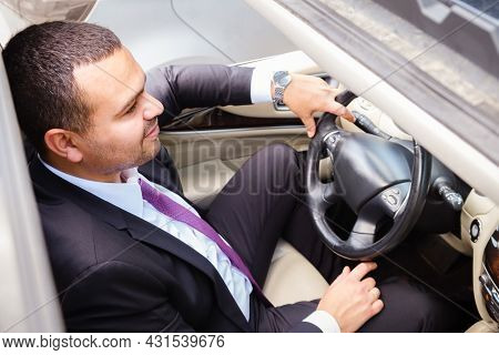 Young Man Of Middle Eastern Appearance In A Business Suit Is Driving An Expensive Car. Businessman D