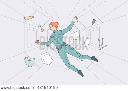 Levitation And Flying In Space Concept. Young Woman Spaceman Cosmonaut In Suit Flying Levitating In