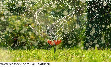 Lawn Water Sprinkler Spraying Water Over Lawn Green Fresh Grass
