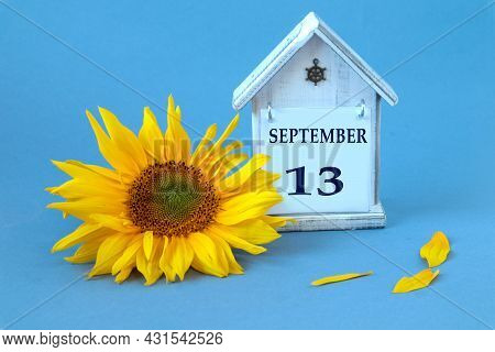 Calendar For September 13 : Decorative House With The Name Of The Month In English, Number 13, Yello