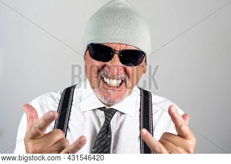 Portrait Of Businessman With Woolen Hat And Sun Glasses