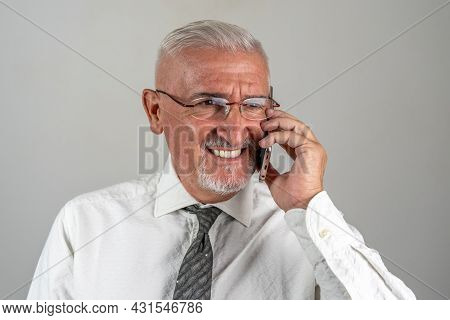 Portrait Of Smiling Businessman Is Calling With A Smart Phone