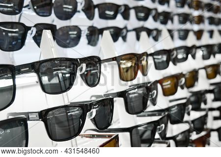 Lot Of Sunglasses On The Counter Of An Optical Store. Assortment Of Sunglasses.