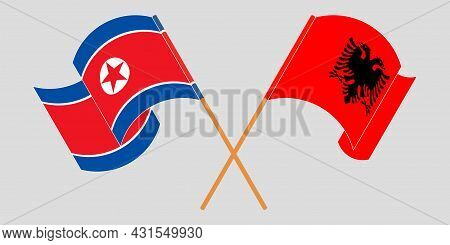 Crossed And Waving Flags Of Albania And North Korea