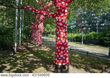 Berlin, Germany - August 11 , 2021 - View Of Trees Decorated With Red Fabric In Berlin.