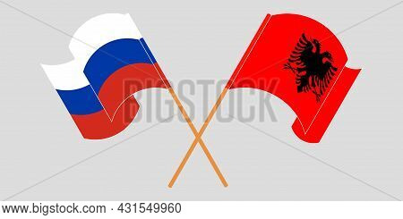 Crossed And Waving Flags Of Albania And Russia