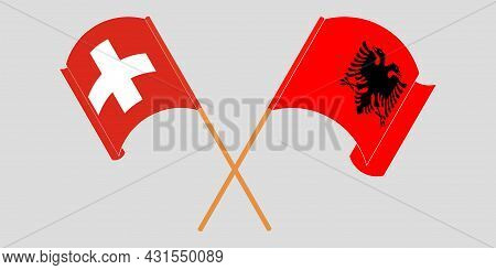 Crossed And Waving Flags Of Albania And Switzerland