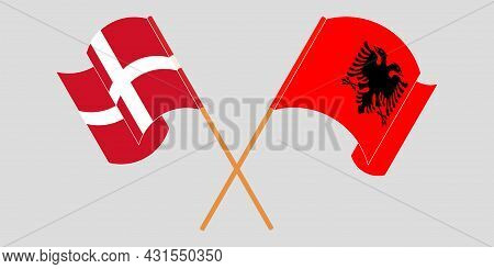 Crossed And Waving Flags Of Albania And Denmark