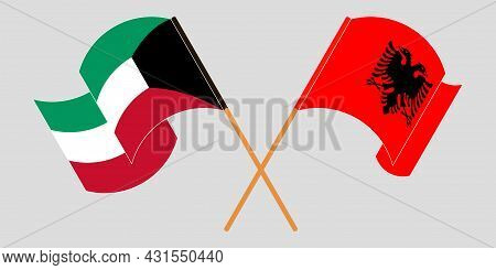 Crossed And Waving Flags Of Albania And Kuwait