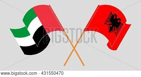 Crossed And Waving Flags Of Albania And The United Arab Emirates