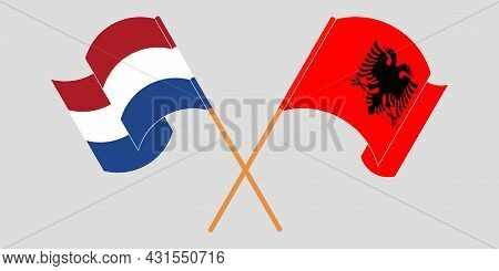 Crossed And Waving Flags Of Albania And The Netherlands