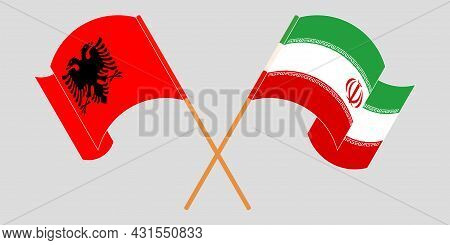 Crossed And Waving Flags Of Albania And Iran