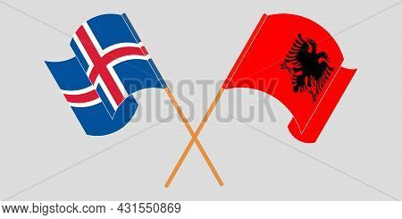 Crossed And Waving Flags Of Albania And Iceland