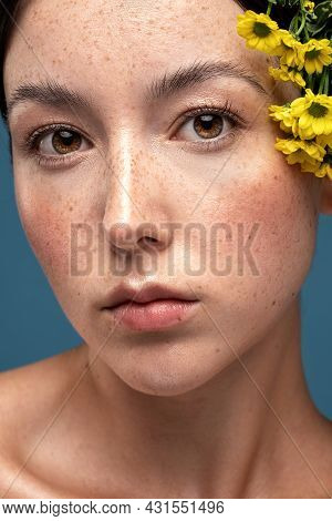 Beauty Portrait Of Young Swedish Natural Woman With Freckles On Face. Girl Is Looking At The Camera.