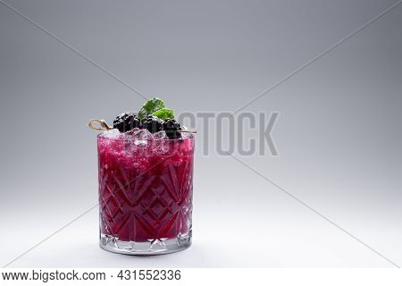 Closeup Of Alcohol Blueberry Special Cocktail With Blackberry In Wineglass