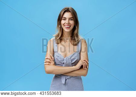Happy Charismatic Adult European Woman With Cute Gap Teeth Smiling Broadly Crossing Hands Against Ch