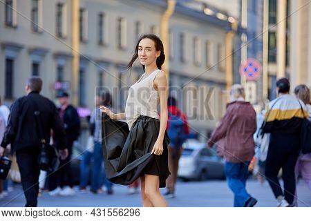Graceful Woman Dances In Crowd On City Street.