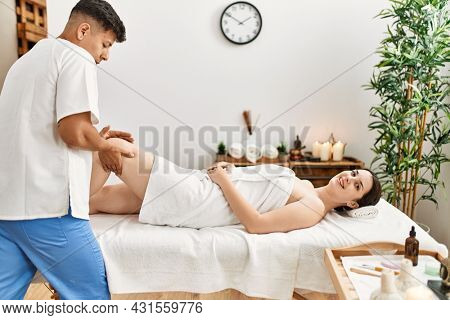 Woman reciving physiotherapy treatment at the clinic.