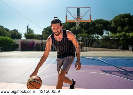 Fit Male Playing Basketball Outdoor, Sunny Weather, Modern Playground. Wide Lense Shot