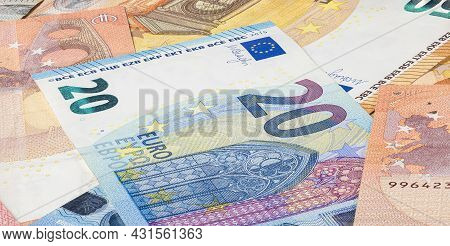 Twenty Euro Bill In Between A Big Pile Of Euro Banknote. Bunch Of Money Of The European Union. Curre