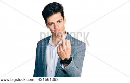Young hispanic man wearing business clothes showing middle finger, impolite and rude fuck off expression
