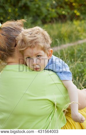 A Heartfelt Moment. Portrait Of A Mother And Her Beloved Son Of European Appearance With Disabilitie