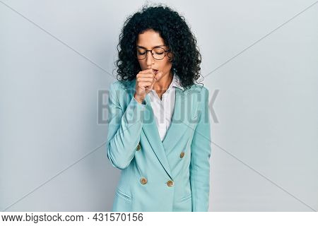 Young latin girl wearing business clothes and glasses feeling unwell and coughing as symptom for cold or bronchitis. health care concept.