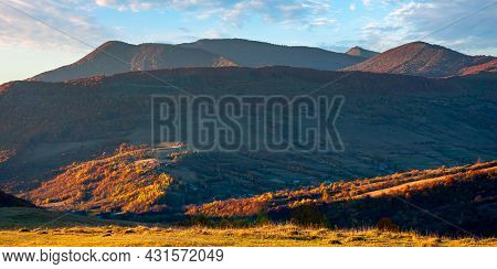 Mountain Landscape In Autumn At Sunset. Beautiful Nature Scenery With Forested Hill And High Peak In
