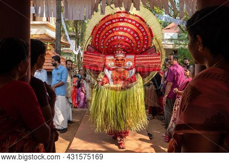 Payyanur, India - December 5, 2019: Theyyam perform during temple festival in Payyanur, Kerala, India. Theyyam is a popular ritual form of worship in Kerala, India