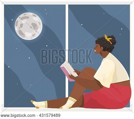 Young Woman Sitting On Windowsill At Home Looking Out Window, Relaxing Reading Book In Evening. Fema