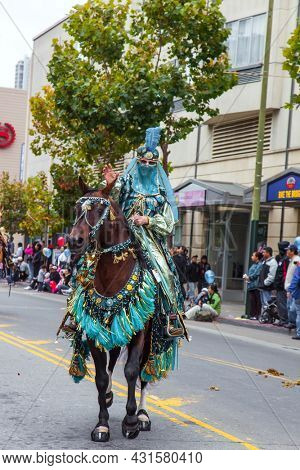 SAN FRANCISCO, USA - OCTOBER 11, 2009: Columbus Day celebration. Equestrian parade in honor of the national holiday. Horsewoman in oriental fancy dress riding on well-groomed horses.