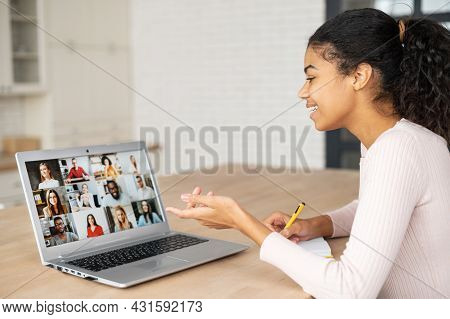 African American Female Student Using Application For Distance Video Communication With Classmates,