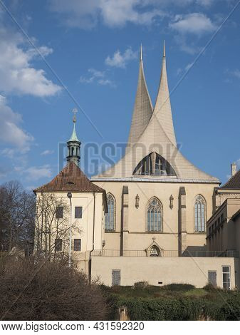 Benedictine Monastery Emauzy, Frontal View. Architectural Monument From Fourteen Century With Two Mo
