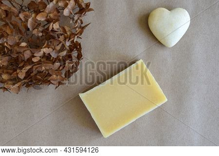 One Piece Of Natural Handmade Soap, Dry Hydrangea Flower And Souvenir Heart On Craft Paper. Aromathe