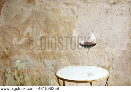 One Wineglasse With Red Wine During Party With Copy Space. Celebration And Holiday Concept