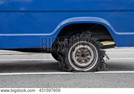 Close Up Of Destroyed Blown Out Tire With Exploded And Damaged Rubber. Flat Tyre. Tyre Explosion On