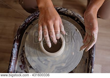 Woman Hands Working On Pottery Wheel And Making A Pot. Young Woman Making Pottery On The Wheel. Scul