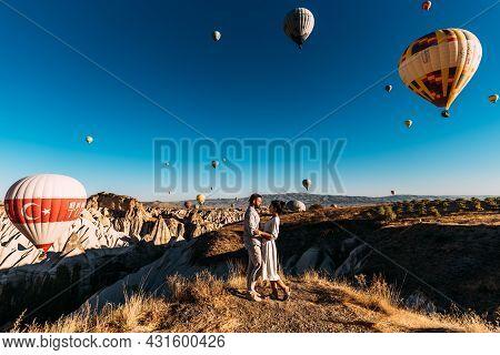 Turkey, Cappadocia - October 10,2018: Early Morning In Cappadocia, The Flight Of Balloons. Couple Tr
