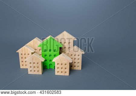 Green Building Stands Out Among The Houses. Search For The Best Option. Net Zero Carbon Neutrality.