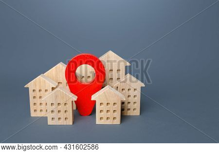 Red Location Pin And Residential Buildings. Realtor Service Agency. Location, Accessibility And Prox