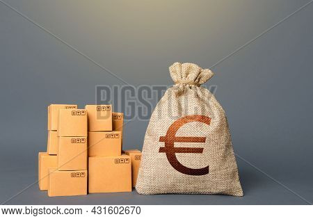 Boxes And Euro Money Bag. The Concept Of Trade In Goods And Production. Business Industry. Deliverin