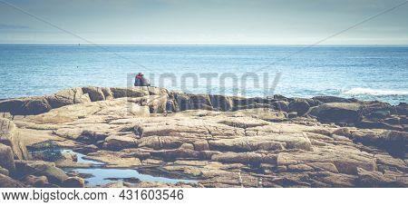 Acadia National Park, ME, October 5, 2020: Elderly couple enjoying a beautiful day on the Atlantic coast of Acadia National Park